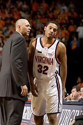 Virginia head coach Dave Leitao talks on the bench with Virginia forward Mike Scott (32).  The Virginia Cavaliers men's basketball team defeated the Boston College Golden Eagles 84-66 at the John Paul Jones Arena in Charlottesville, VA on January 19, 2008.