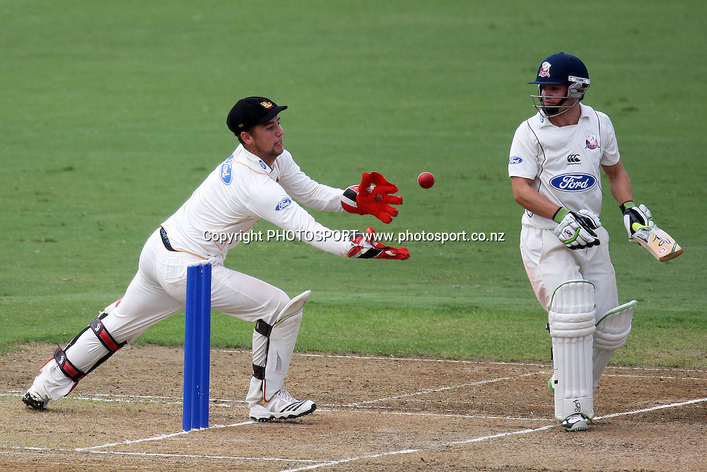 Wicket keeper Joe Austin-Smellie makes an akward catch to dismiss Bradley Cachopa, Plunket Shield, 4 day domestic cricket. Auckland Aces v Wellington Firebirds, Colin Maiden Park, Auckland. 23 March 2011. Photo: William Booth/photosport.co.nz