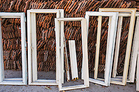 White wooden window frames to be re-used whilst restoring a house in the city of Baile Herculane, Caras Severin, Romania.