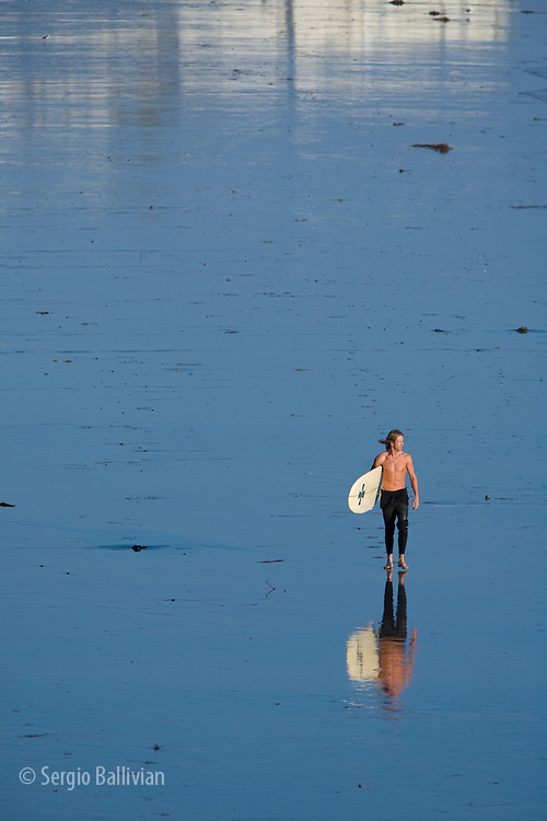 Portraits of a surfer on the Pacific Ocean on a beach near Los Angeles, CA