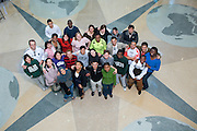 18606International students Group Photo w/flags in Lobby of Baker Center for International week poster..Model release on file