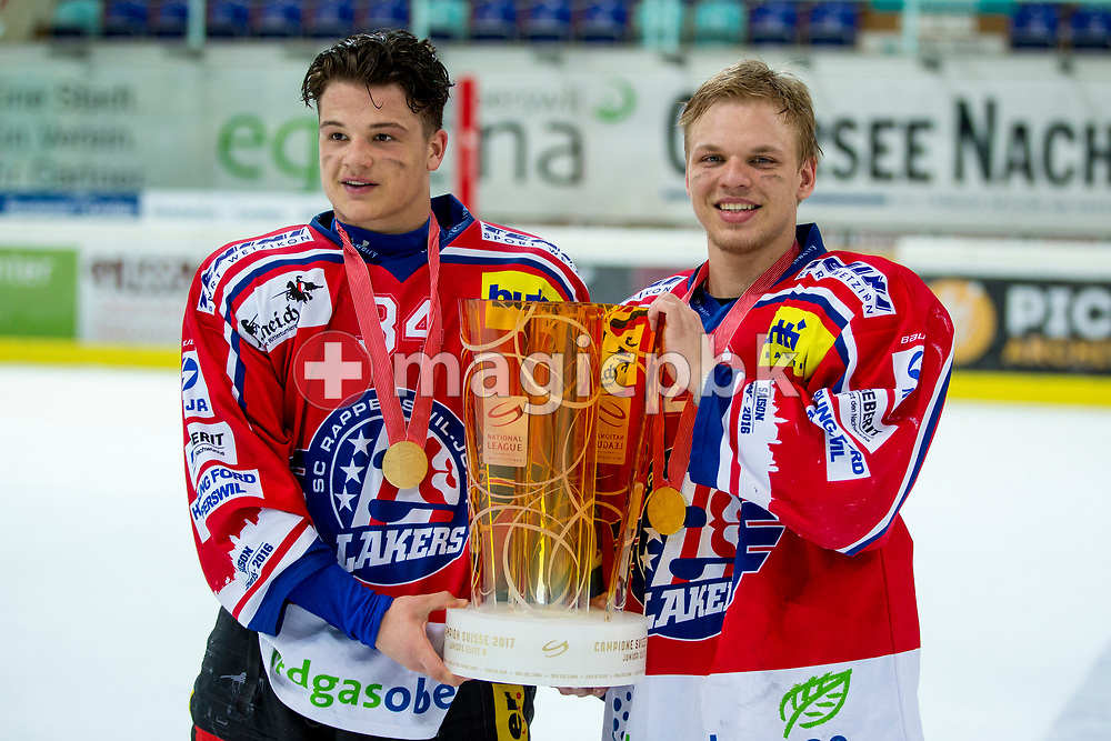 (L-R) Rapperswil-Jona Lakers defenseman Janis Egger and Cedric Sieber pose for a photo with his gold medal and the Swiss Championships trophy after winning the fifth Elite B Playoff Final ice hockey game between Rapperswil-Jona Lakers and ZSC Lions held at the SGKB Arena in Rapperswil, Switzerland, Sunday, Mar. 19, 2017. (Photo by Patrick B. Kraemer / MAGICPBK)