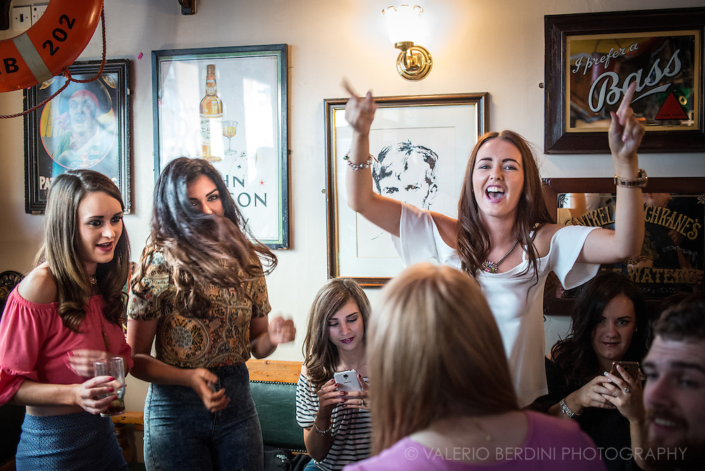 A group of Northern Irish girls have a singing moment in a Derry pub night.