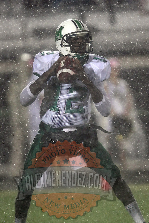 Marshall quarterback Rakeem Cato (12) in the rain during an NCAA football game between the Marshall Thundering Herd and the Central Florida Knights at Bright House Networks Stadium on Saturday, October 8, 2011 in Orlando, Florida. (Photo/Alex Menendez)