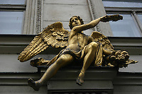 Gold statue above a doorway in Prague, Czech republic<br />
