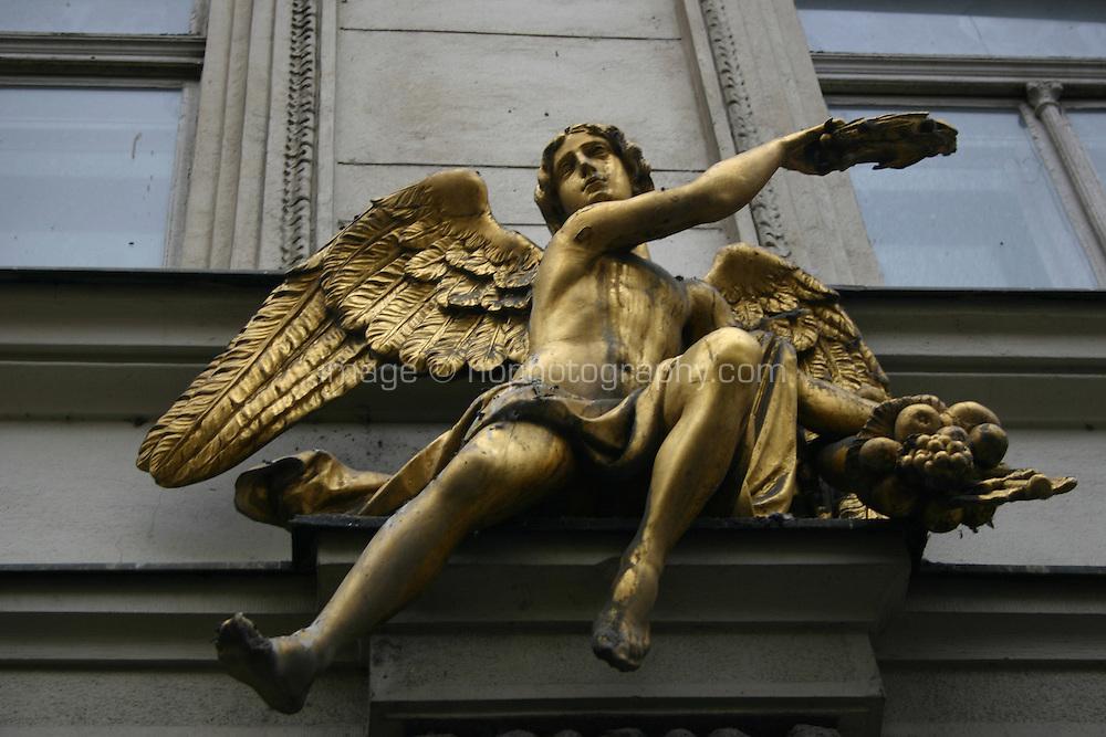 Gold statue above a doorway in Prague, Czech republic<br />