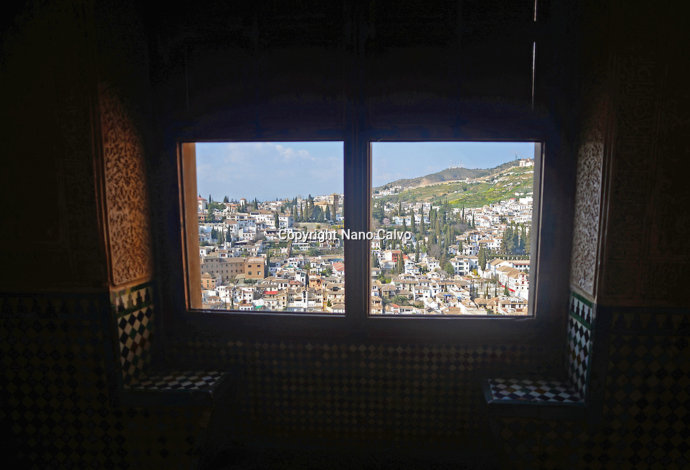 View of Granada from window in Nasrid Palaces at The Alhambra, palace and fortress complex located in Granada, Andalusia, Spain