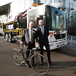 London, UK - 9 december 2013: Sir Peter Hendy, CBE, commissioner of Transport of London (L) and Andrew Gilligan, London's cycling commissioner (R), stand next to a new construction lorry with vastly improved driver visibility and safety equipment nearby City Hall.
