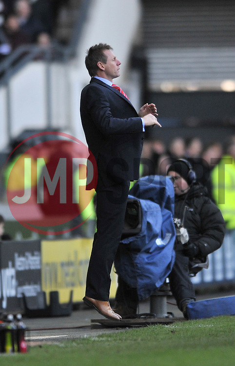 Nottingham Forest Manager, Stuart Pearce jumps in frustration as his team comes close to scoring - Photo mandatory by-line: Dougie Allward/JMP - Mobile: 07966 386802 - 17/01/2015 - SPORT - Football - Derby - iPro Stadium - Derby County v Nottingham Forest - Sky Bet Championship