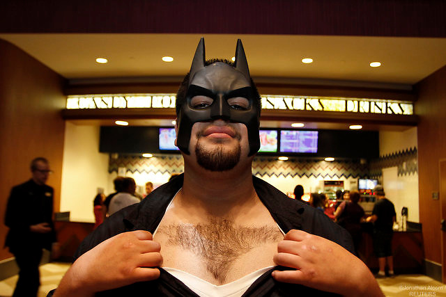 Jesus Alamo shows a Batman logo shaved into his chest hair waiting for the midnight premiere of ?The Dark Knight Rises?, the final installment of Christopher Nolan's Batman trilogy, in Universal City, California, July 19, 2012.  REUTERS/Jonathan Alcorn (UNITED STATES).