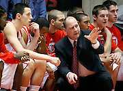 Utah head coach Jim Boylen talks with his players during the first half of an NCAA college basketball game against UNLV in Salt Lake City, Utah, Saturday, March. 5, 2011. (AP Photo/Colin E Braley)
