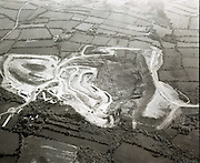 Silvermines From The Air.  (J54)<br /> 1975.<br /> 20.05.1975<br /> 05.20.1975.<br /> 20th May 1975.<br /> Silvermines is a small village in Co Tipperary.  It lies immediately north of the Silvermine mountain range and takes its name from the extensive mines of lead, zinc, copper and silver nearby. Here is a series of images of Silvermines taken from the air. The Images show the mining area and its setting in the surrounding countryside.