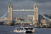 A Thames Clipper passenger riverboat service heads towards downriver after passing beneath Tower Bridge on the river Thames, on 17th January 2020, in London, England.