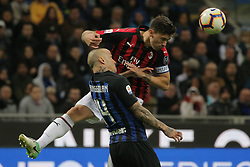 October 21, 2018 - Milan, Milan, Italy - Alessio Romagnoli #13 of AC Milan competes for the ball with Radja Nainggolan #14 of FC Internazionale Milano during the serie A match between FC Internazionale and AC Milan at Stadio Giuseppe Meazza on October 21, 2018 in Milan, Italy. (Credit Image: © Giuseppe Cottini/NurPhoto via ZUMA Press)