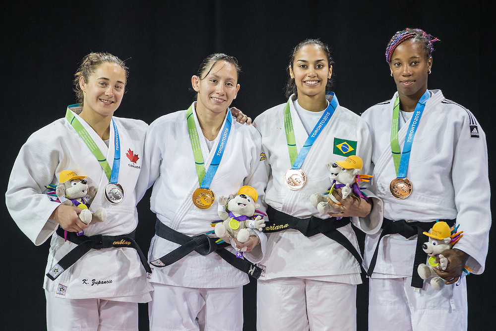 (from Left) Silver medalist Stephanie Tremblay of Canada, Gold medalist Estefania Garcia of Ecuador, Bronze medalists Mariana Silva of Brazil and<br /> Maylin Del Toro of Cuba  pose for a photo with their medals following the medal ceremony for the women's judo -63kg class at the 2015 Pan American Games in Toronto, Canada, July 13,  2015.  AFP PHOTO/GEOFF ROBINS