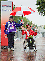 Sandra Graf (SUI) second place winner at the medal ceremony for the Womens Handcycle Classic at Prudential RideLondon, the world's greatest festival of cycling, involving 70,000+ cyclists – from Olympic champions to a free family fun ride - riding in five events over closed roads in London and Surrey over the weekend of 9th and 10th August. <br /> <br /> Photo: Neil Turner for Prudential Ride London<br /> <br /> Sunday 10th August 2014<br /> <br /> See www.PrudentialRideLondon.co.uk for more.<br /> <br /> For further information: Penny Dain 07799 170433<br /> pennyd@ridelondon.co.uk