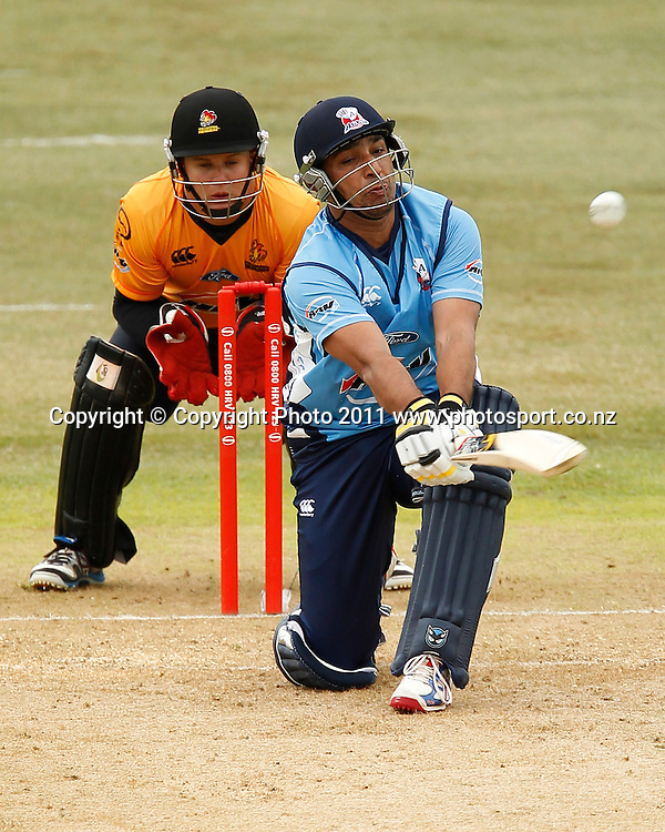 Azhar Mahmood of the Aces bats as Craig Cachopa of the Firebirds keeps wicket during the HRV Cup Cricket Twenty-20,  Auckland Aces v Wellington Firebirds, Colin Maiden Park Auckland, Sunday 18 December 2011. Photo: Simon Watts/www.photosport.co.nz