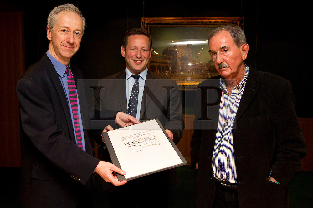 """© Licensed to London News Pictures. 22/05/2013. London, UK. Roly Keating, the chief executive of the British Library (L), Ed Vaizey, the British Minister for Culture (C) and Hunter Davies, an acclaimed Beatles Biographer, are seen with the lyrics for the Beatles song 'She Said She Said' (1966) at the British Library in London today (22/05/2013).  The manuscript, along with others and letters between John Lennon and Mr Davies, have been donated to the library under the """"lifetime giving"""" scheme. Photo credit: Matt Cetti-Roberts/LNP"""