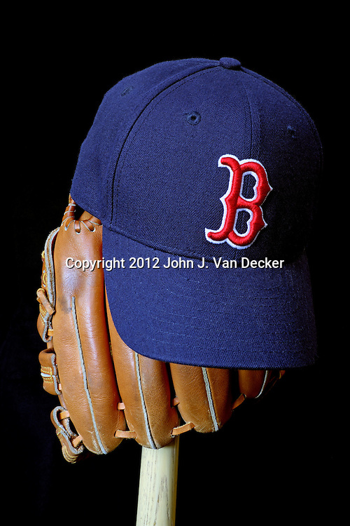 Wait till next year. Boston Red Sox baseball cap on a glove and bat.