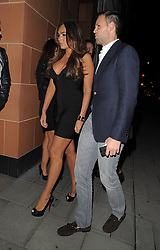 Tamara Ecclestone wearing a very fitted black bandage dress, that accentuated her bust, seen arriving a Cipriani's restaurant in London. UK. 06/10/2012 <br />