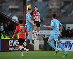 Exeter City's David Wheeler challenges for the header with  Tranmere Rovers's Adam Dugdale - Photo mandatory by-line: Dougie Allward/JMP - Mobile: 07966 386802 - 31/01/2015 - SPORT - Football - Exeter - St James Park - Exeter City v Tranmere Rovers - Sky Bet League Two