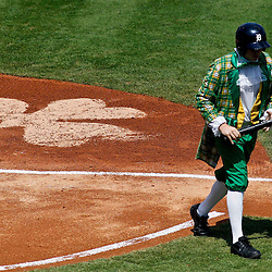 March 17, 2012; Lakeland, FL, USA; A bat boy dressed as a leprechaun  brings a bat back to the Detroit Tigers dugout during the bottom of the first inning of a spring training game against the St. Louis Cardinals at Joker Marchant Stadium. Both teams wore green jerseys and the field was marked with shamrocks for the St. Patrick's Day game. Mandatory Credit: Derick E. Hingle-US PRESSWIRE