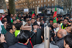 London February 15th 2015. British Pakistanis demonstrate outside Downing Street against Altaf Hussain a Pakistani politician living in exile as a naturalised citizen in the United Kingdom. The Muttahida Qaumi Movement (MQM) leader  is accused of masterminding dozens of politically motivated murders in Pakistan.PICTURED: George Galloway, centre, addresses the protest.  //Contact/payment details tel 07966016296 paul@pauldaveycreative.co.uk