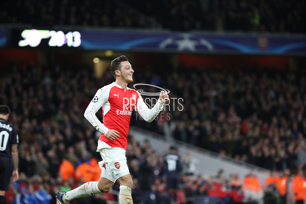 Arsenal midfielder Mesut Ozil celebrating scoring first goal of the game during the Champions League match between Arsenal and Dinamo Zagreb at the Emirates Stadium, London, England on 24 November 2015. Photo by Matthew Redman.