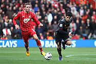Picture by Daniel Chesterton/Focus Images Ltd +44 7966 018899.16/03/2013.Jos Hooiveld of Southampton and Luis Suarez of Liverpool in action during the Barclays Premier League match at the St Mary's Stadium, Southampton.