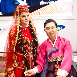 Milan, Italy - February  17:  Azerbaijan dancer and korean woman at BIT International Tourism Exchange on february 17, 2012 in Milan, Italy.