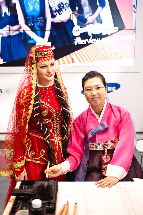 Milan, Italy - February  17:  Azerbaijan dancer and korean woman at BIT International Tourism Exchange on february 17, 2012 in Milan, Italy.