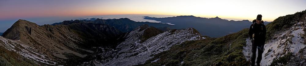 Stu nears the summit of Snow Mountain, Taiwan just before sunrise.