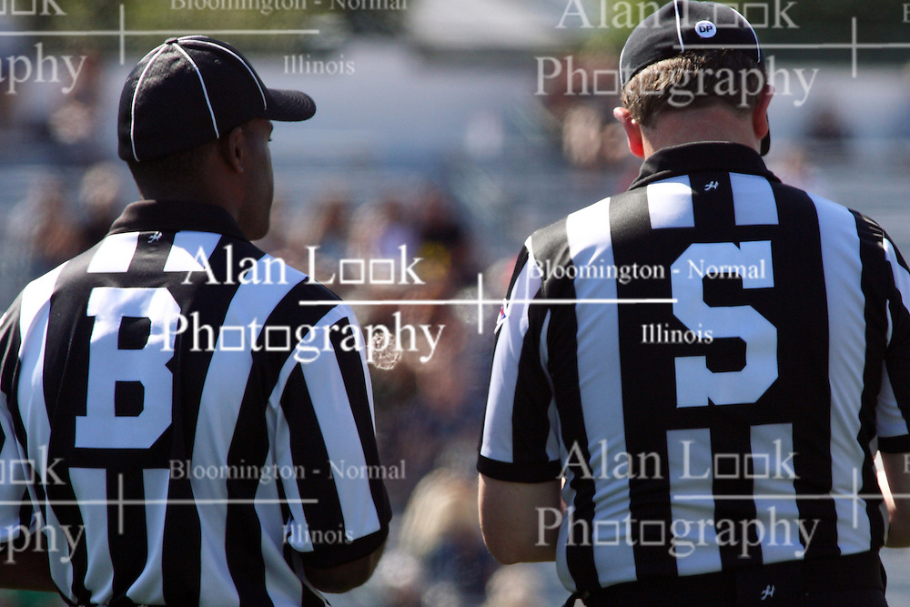 17 September 2011: Back Judge Bryan Banks and Side Judge Steve Mitze compare notes during an NCAA Division 3 football game between the Aurora Spartans and the Illinois Wesleyan Titans on Wilder Field inside Tucci Stadium in.Bloomington Illinois.