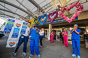 Floral hearts, donated by a local business, adorn the front entrance - Hospital staff come out of Chelsea and Westminster and are greeted by a small but enthusiastic crowd, this time, for the first time, there were no Police Officers - Clap for carers, to say thanks to NHS and other key workers and carers. The 'lockdown' continues in London - Coronavirus (Covid 19) outbreak in London.