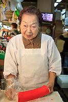 An Okinawan lady working in the fish markets off Kokusai Doori, or International Street, in Naha, Okinawa, Japan.