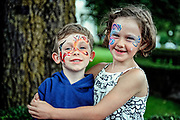 Brother and sister proudly display their face paintings.
