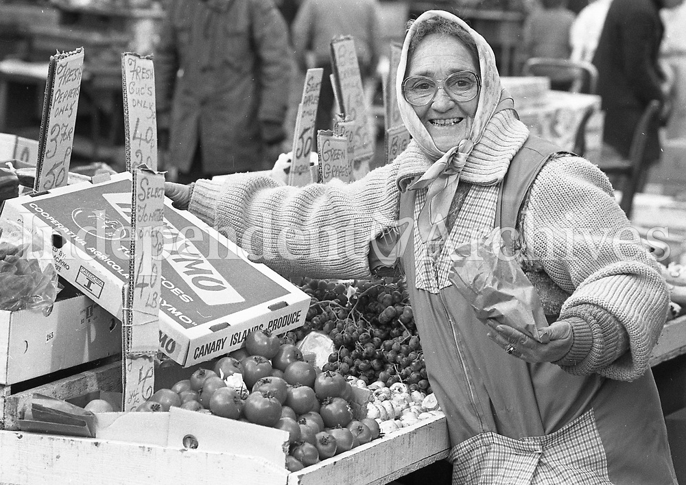Liz Scully, a Moore St. trader selling Canary Island frozen tomatoes.  February 1986.<br />