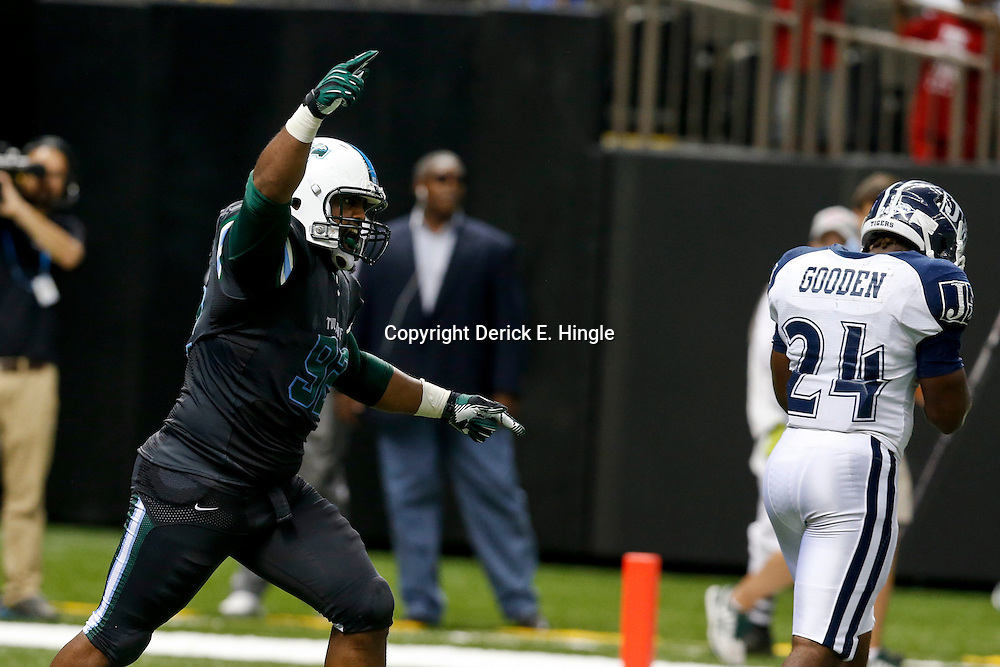Aug 29, 2013; New Orleans, LA, USA; Tulane Green Wave defensive tackle Julius Warmsley (92) celebrates after a turnover during the second quarter against the Jackson State Tigers at the Mercedes-Benz Superdome. Mandatory Credit: Derick E. Hingle-USA TODAY Sports