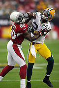 Green Bay Packers cornerback Jarrett Bush (24) grapples with Arizona Cardinals wide receiver Early Doucet (80) during the NFC Wild Card Game against the Arizona Cardinals, January 10, 2010 in Glendale, Arizona. The Cardinals won the game 51-45 in overtime. ©Paul Anthony Spinelli
