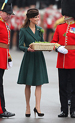 Catherine, Duchess of Cambridge presents  sprigs  of shamrock  to members of  the 1st Battalion Irish Guards  during a St Patricks Day Parade at Mons Barracks, Aldershot, Saturday 17th March 2012. .Photo by: Stephen Lock / i-ImagesCatherine, Duchess of Cambridge at the 1st Battalion Irish Guards  St Patricks Day Parade at Mons Barracks, Aldershot, Saturday 17th March 2012. .Photo by: Stephen Lock / i-Images.