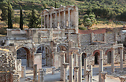 The South East corner of the Tetragonos Agora, or commercial market square, the Gate of Mazeus and Mythridates with its 3 passages on the left, and the first floor of the Library of Celsus in the distance, Ephesus, Izmir, Turkey. Ephesus was an ancient Greek city founded in the 10th century BC, and later a major Roman city, on the Ionian coast near present day Selcuk. Picture by Manuel Cohen
