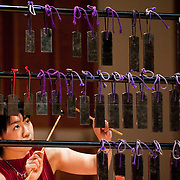 "February 18, 2012 - New York, NY : .Kyoko Kato, on hokoyo, performs Maki Ishii's 'Chronology 1200' (1994) during ""Resonances of the Kugo,"" part of the 2012 New York Music From Japan Festival, at Merkin Concert Hall on Saturday. .CREDIT: Karsten Moran for The New York Times"