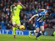 Huddersfield Town striker Nahki Wells & Brighton player Jamie Murphy compete for the loose ball during the Sky Bet Championship match between Brighton and Hove Albion and Huddersfield Town at the American Express Community Stadium, Brighton and Hove, England on 23 January 2016. Photo by Bennett Dean.