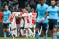 02-10-2016: Voetbal: Ajax v FC Utrecht: Amsterdam<br /> <br /> (L-R)Ajax speler Hakim Ziyech heeft gescoord  tijdens het Eredivsie duel tussen Ajax en FC Utrecht op 2 oktober 2016 in stadion Arena in Amsterdam tijdens speelronde 8<br /> <br /> Eredivisie - Seizoen 2016 / 2017<br /> <br /> Foto: Gertjan Kooij