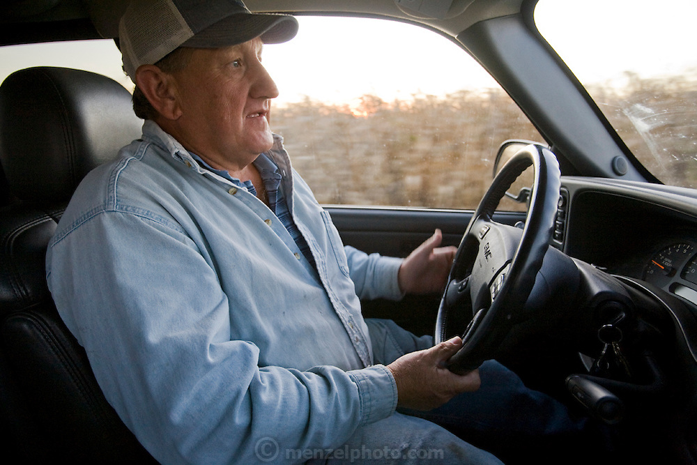 Grain Farmer Gordon Stine driving a truck at his leased farm in St. Elmo, Illinois.  (Gordon Stine is featured in the book What I Eat; Around the World in 80 Diets.)