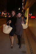 Karla Otto and Victoria Fernandez with goody bag. Launch dinner for Island Beauty by India Hicks hosted by Charles Finch and Harvey Nichols Fifth Floor Restaurant. London. .  14  November 2005 . ONE TIME USE ONLY - DO NOT ARCHIVE © Copyright Photograph by Dafydd Jones 66 Stockwell Park Rd. London SW9 0DA Tel 020 7733 0108 www.dafjones.com