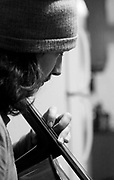 Caleb Elliott  plays cello Monday in Florence during practice for Dylan LeBlanc's upcoming shows. Elliott recently moved to Florence from Louisiana to do studio work and play cello for LeBlanc.