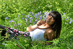 Italian tourist Giulia Pisu enjoys the bluebells  and hot spring weather in London's Regent's Park.<br /> Wednesday, 16th April 2014. Picture by Ben Stevens / i-Images