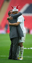 LONDON, ENGLAND - Saturday, May 30, 2011: Swansea City's manager Brendan Rodgers and Ashley Williams celebrate after beating Reading 4-2 during the Football League Championship Play-Off Final match at Wembley Stadium. (Photo by David Rawcliffe/Propaganda)