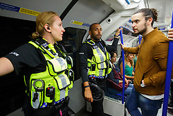 © Licensed to London News Pictures. 20/08/2016. London, UK. British Transport Police patrols on the night tube service of Victoria line in London for the first time on 20 August 2016. Transport for London started a 24-hour Tube service on Victoria and Central lines as demand has soared over recent years, with passenger numbers on Friday and Saturday nights up by around 70 per cent since 2000. The plan was announced in November 2013 and intended to begin in September 2015, but strikes over pay delayed the start by nearly another year. Photo credit: Tolga Akmen/LNP